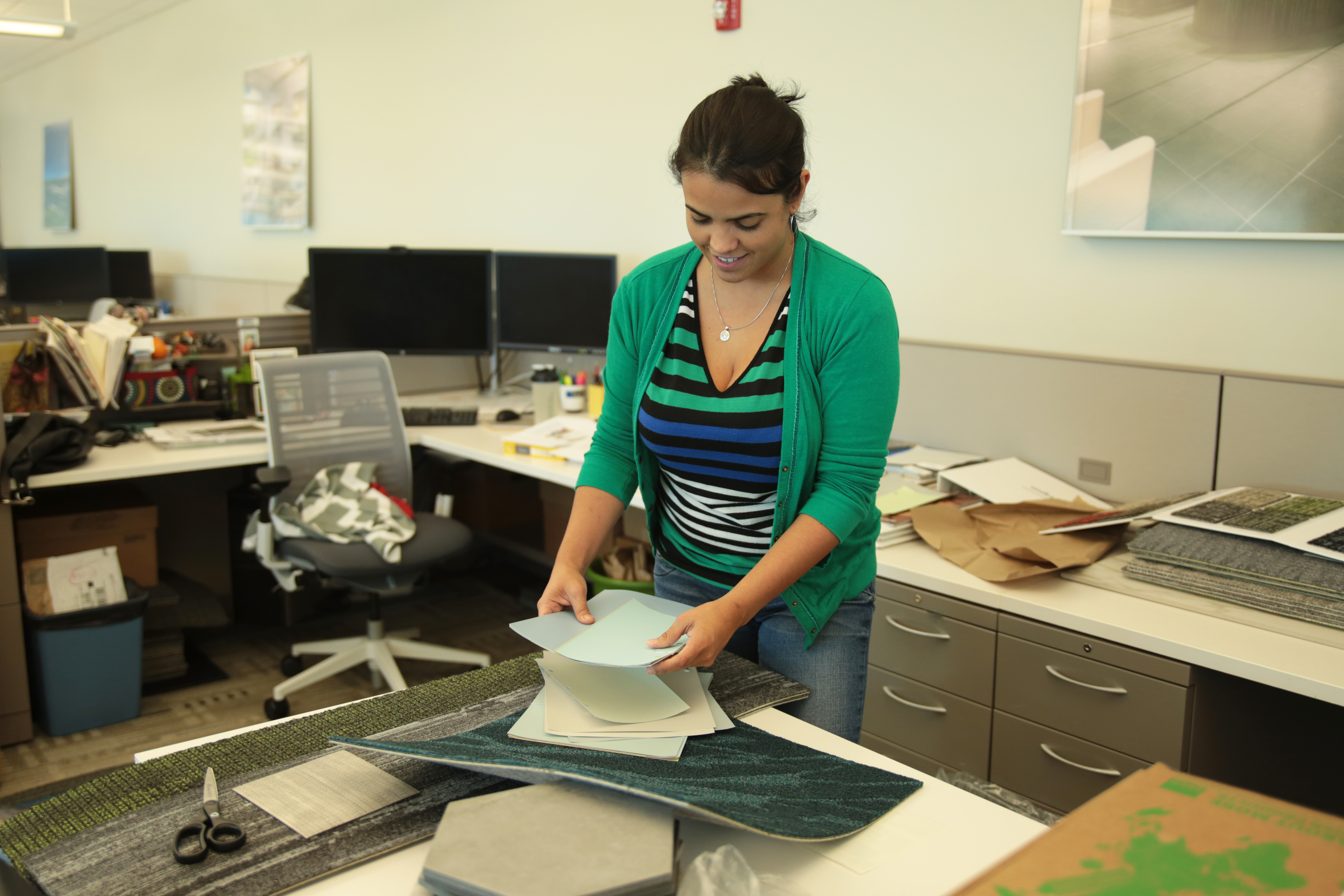 A woman looking over documents dealing with sustainable design